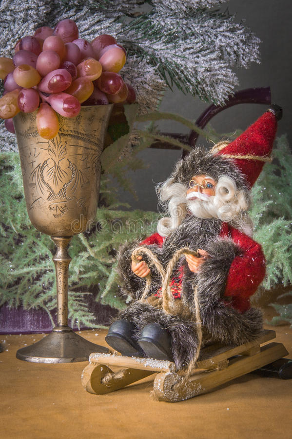 Close-up Christmas decoration Santa-Claus on the sladge. And fruit stock image