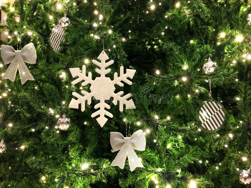 Close-up Christmas festival`s ornament for decoration hang on the pine tree branches, horizontal view. stock photography