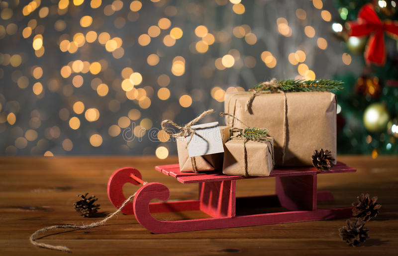 Close up of christmas gift boxes on wooden sleigh stock image
