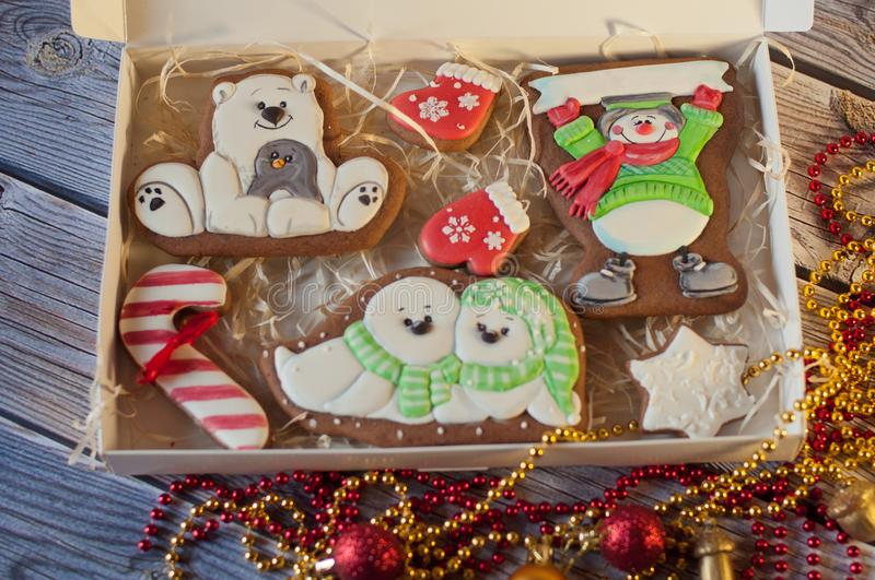 Close up of Christmas gingerbread set. Different colorful cookie figures in box. Top view stock image