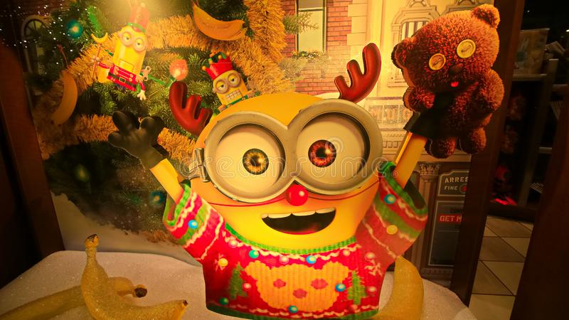 Close up of Christmas Happy holiday version of HAPPY MINION statue. OSAKA, JAPAN - Dec 21, 2017 : Close up of Christmas Happy holiday version of HAPPY MINION stock photos