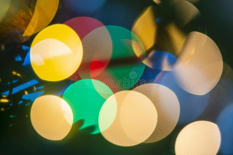 Close up of Christmas lights and ornaments on a Douglas fir tree stock images