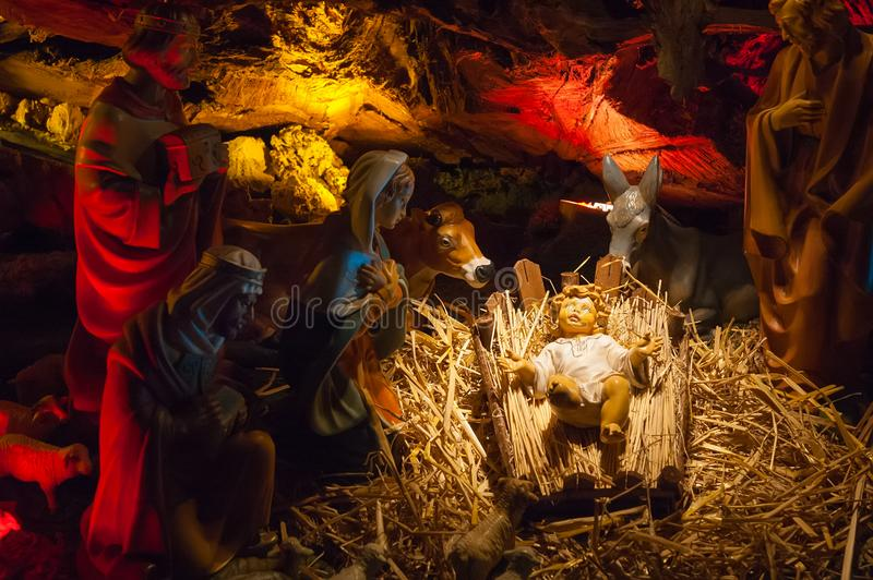 Christmas nativity scene with Holy family. Close-up of Christmas nativity scene with Holy family, three kings and animals stock photos