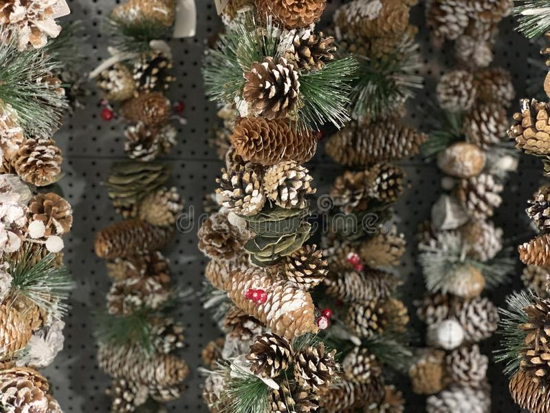 Close-up of Christmas rustic decorations, garlands, pine cones. royalty free stock photos