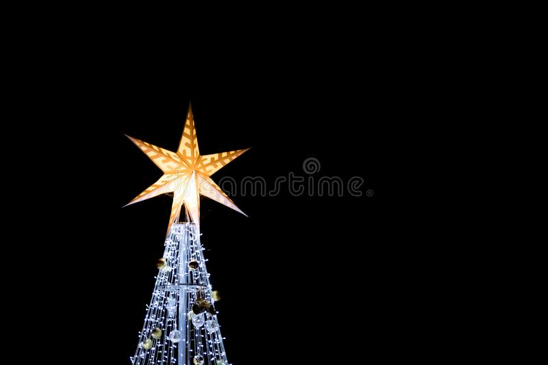 Close up of Christmas tree background on night sky. Night seen stock images