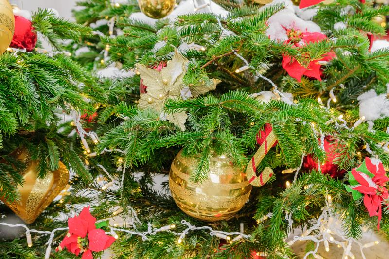 Close up of christmas tree decorated with balls, toys and garlands. Festive background.  stock image