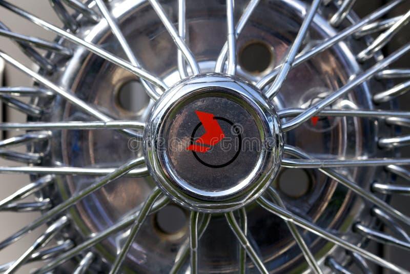 Close up of a chrome spoke wheel hub cap on a classic car royalty free stock photos