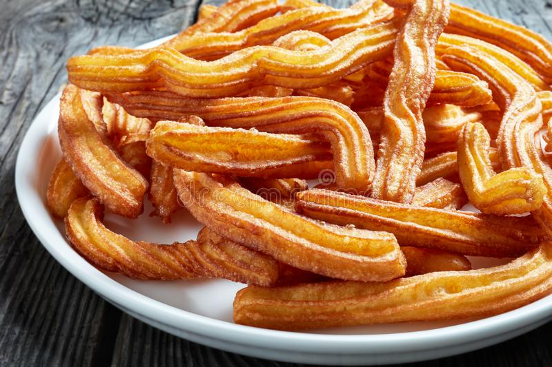 Close-up of churros - spanish street food on plate royalty free stock photos
