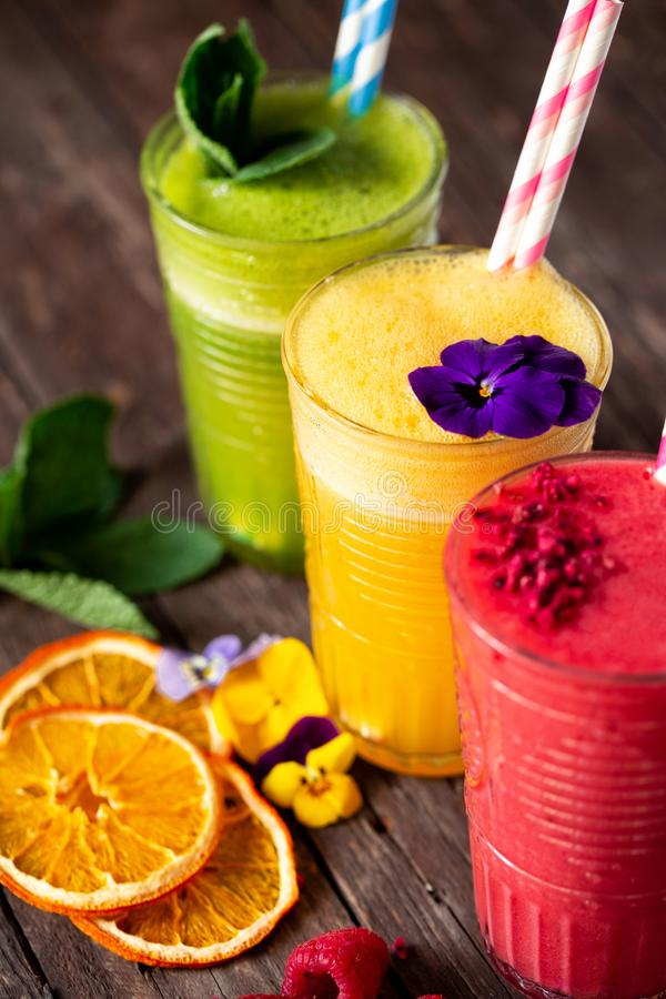 Close up of citrus and berry smoothies full with of vitamin C and antioxidants stock photos