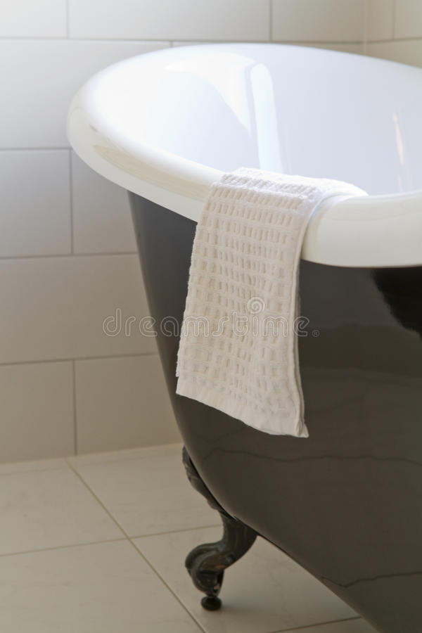 Close up of a claw foot bath. Close up of a black claw foot bath in a contemporary bathroom stock photos