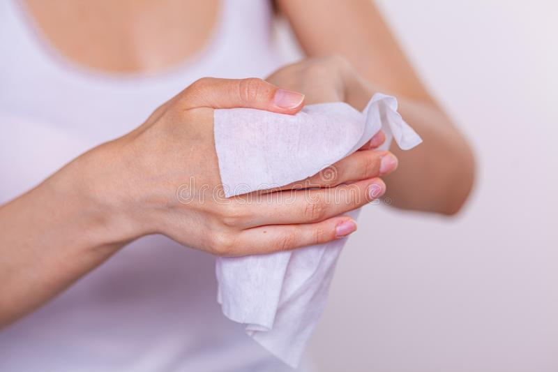 Close-up of cleaning hands with wet wipes. White royalty free stock photo