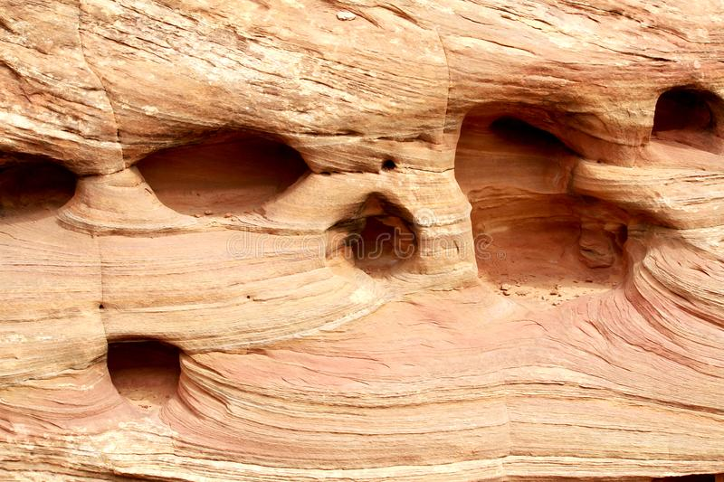 Close up of a cliff wall holes in Utah. This is a close up of a portion of a cliff located in Utah. The photograph shows the natural patterns present in the royalty free stock images