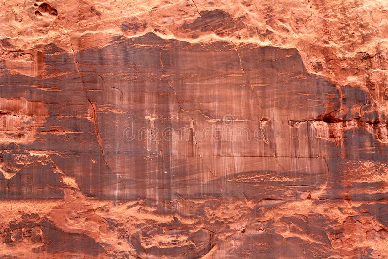 Close up of a cliff wall in Utah. This is a close up of a portion of a cliff located in Utah. The photograph shows the natural patterns present in the rock stock photography