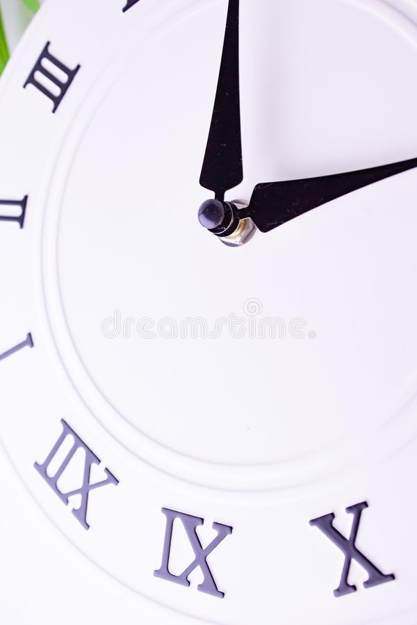 Close up clockwise. The face of the white wall clock. stock image