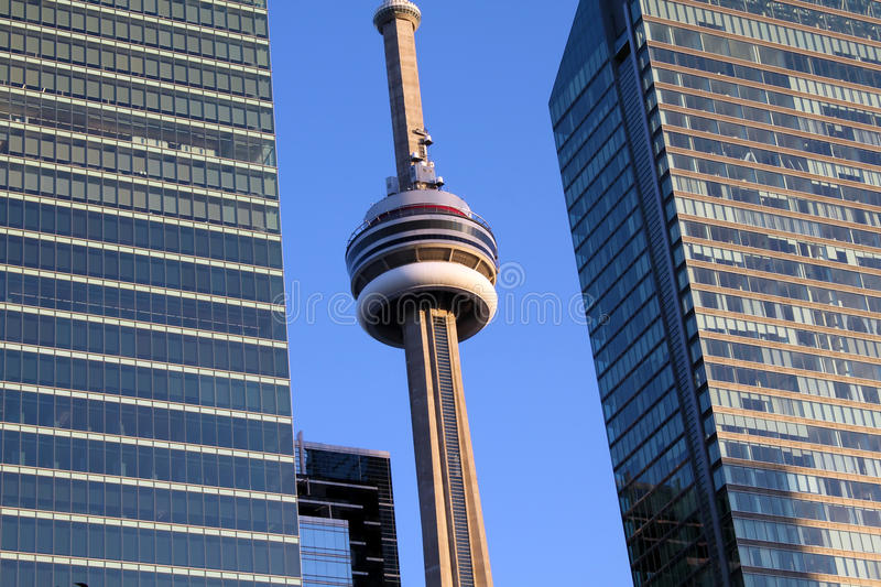 Close up of the CN Tower between two office buildings in downtown Toronto, Ontario, Canada royalty free stock photography