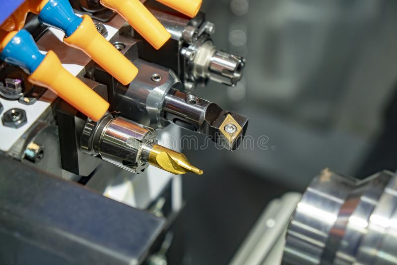 Close-up of the CNC lathe machine or turning machine. With the cutting tool,drill tool.The high technology manufacturing concept royalty free stock image