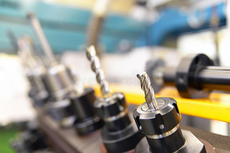 Close up of CNC Mechanical Tools for production of engineering p. Arts royalty free stock photo