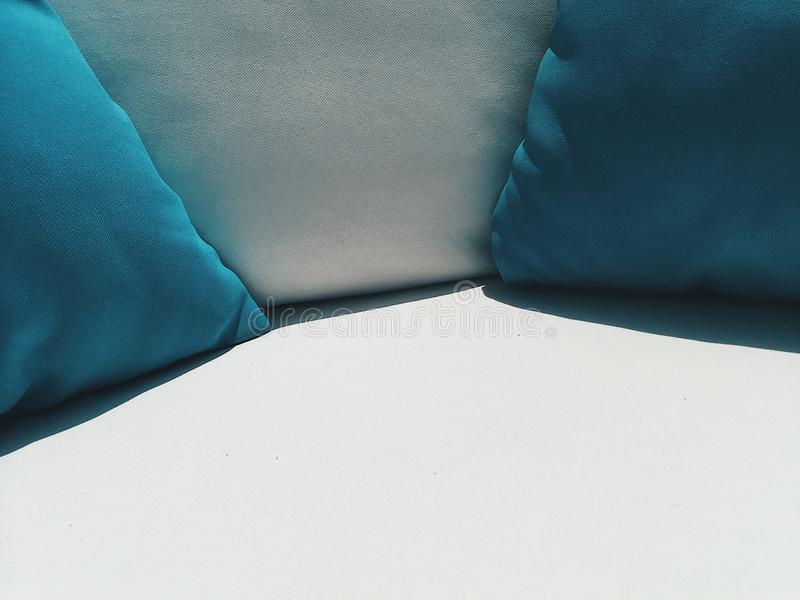 Close up coach with blue and white pillows outside at cafe terrace at sunny day. Background royalty free stock images
