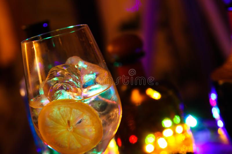Close up of cocktail with slices of lemon and ice cubes royalty free stock photos