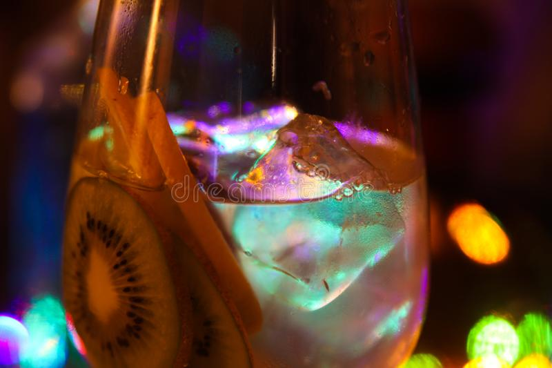 Close up of cocktail with slices of lemon and ice cubes royalty free stock photo
