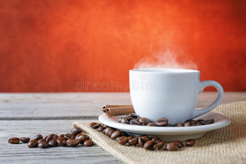 Close up coffee cup. Composition on wood background stock photography