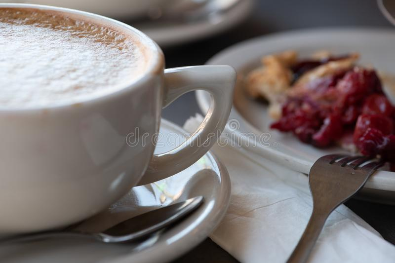 Coffee and cherry pie on a plate stock photo
