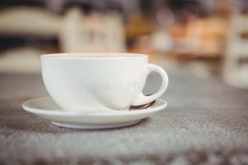 Close-up of coffee cup on a table. In cafeteria royalty free stock images