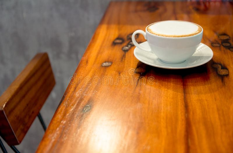 Close up coffee cup on the table. At coffee shop stock photography
