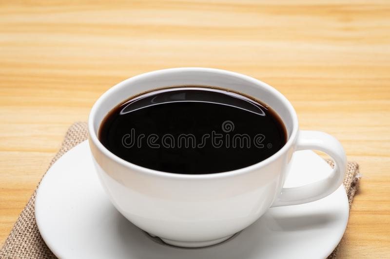 Close up of coffee cup on wood background.  royalty free stock image