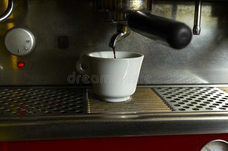 Close-up of coffee machine. Coffee machine preparing fresh coffee and pouring into cups at restaurant. stock images
