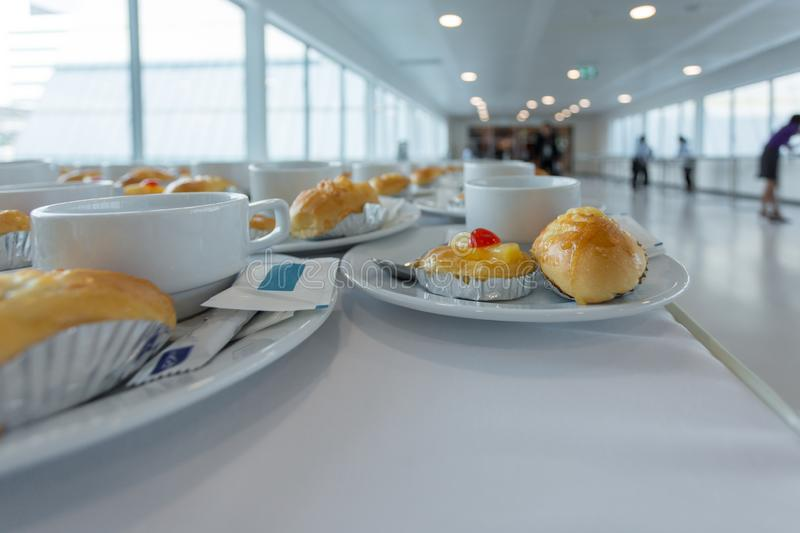 Close up coffee white cup and dessert prepare for breakfast in convention hall. Background, beverage, buffet, business, cafe, closeup, drink, empty, event royalty free stock image