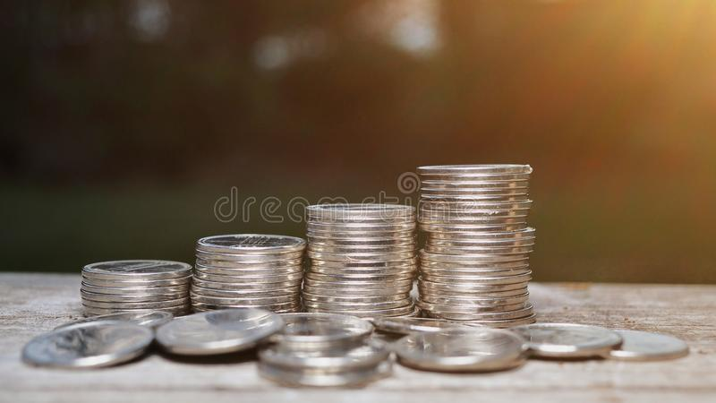 Close up coin stacks on wooden royalty free stock photos