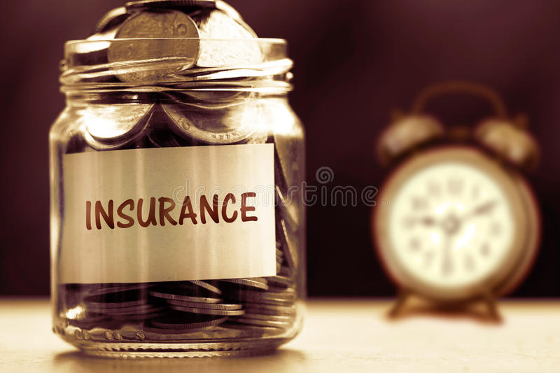 Close up Coins in glass jar for time to Insurance and Business stock images