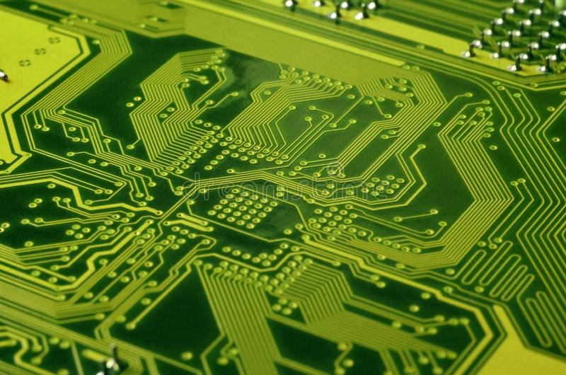 Close up of colored micro circuit board. Abstract technology background. Computer mechanism in detail stock photos