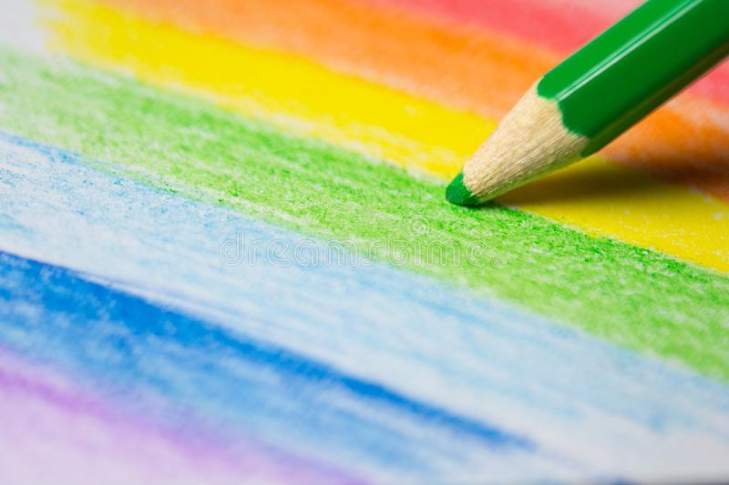 Close up of a colored pencil drawing a colorful rainbow stock photos