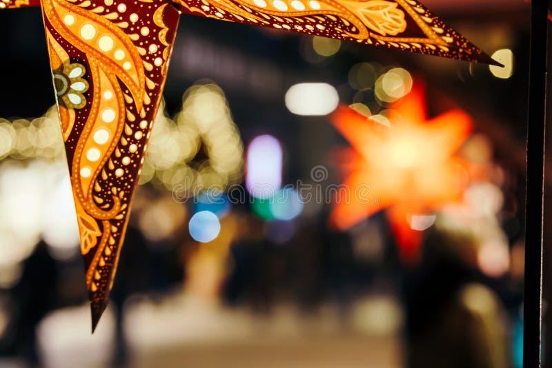Close up of coloreful stars illuminated on Xmas tree at Christmas Market in Hamburg, Germany stock photography