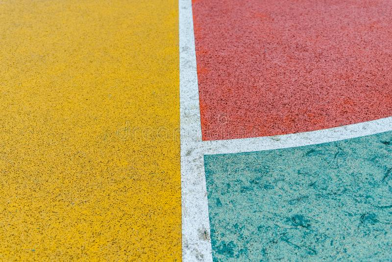 Colorful basketball outdoor court, Red, Yellow and Green with White line royalty free stock photos