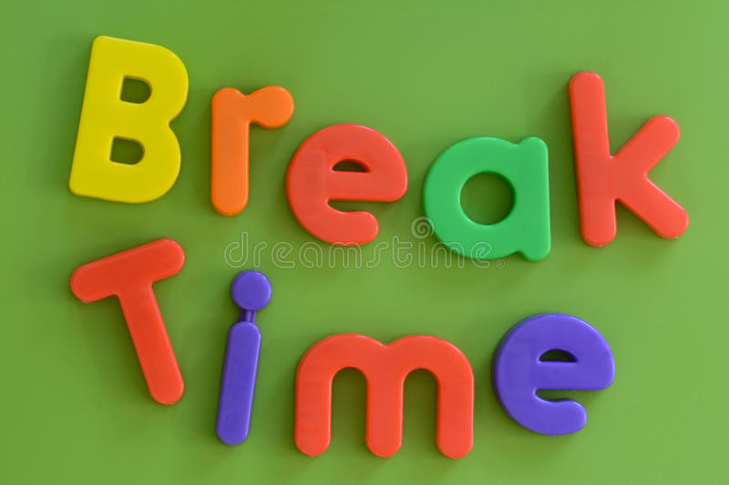 Close up of colorful Break Time words in plastic l. Close up of Break Time words in colorful plastic letters on green background royalty free stock photos