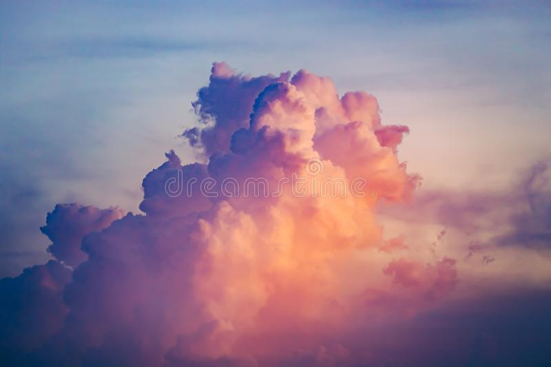Close-up colorful clouds going up in sunset sky. stock photo
