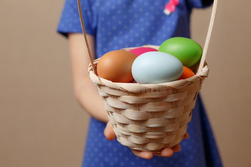 Colorful Easter eggs in a basket royalty free stock photos
