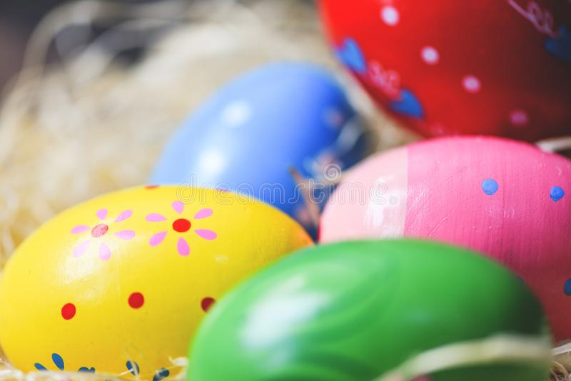 Close up colorful easter eggs in basket nest stock photo