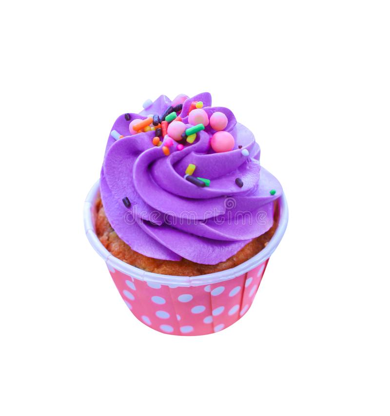 Colorful holiday cupcakes with purple whipped cream and multicolored topping on pink vivid paper cup isolated on white background. Close up Colorful holiday royalty free stock image