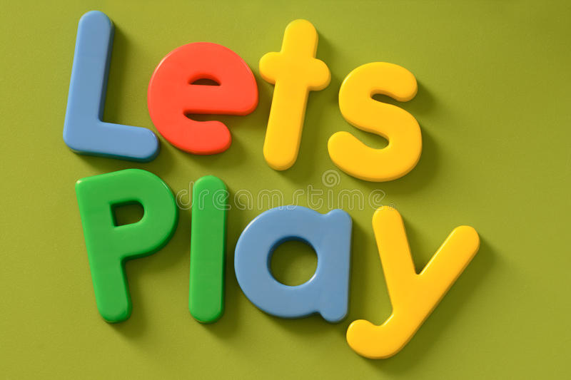 Close up of colorful Lets Play words on green back royalty free stock photos