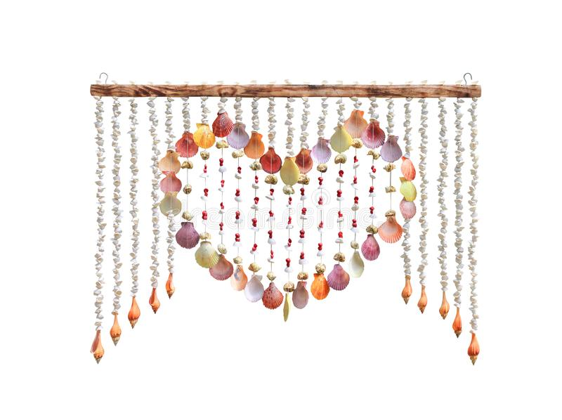 Colorful multicolored shells curtain in line patterns and heart shaped frame hanging on wood isolated on white background with royalty free stock images