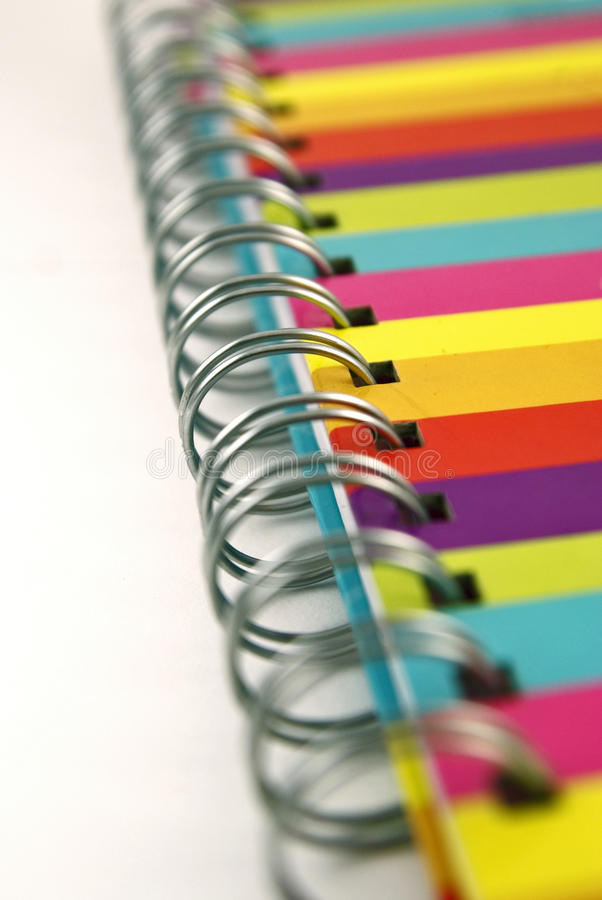 Close up of colorful notebook spiral binding. Close up of binding of colorful notebook royalty free stock photography