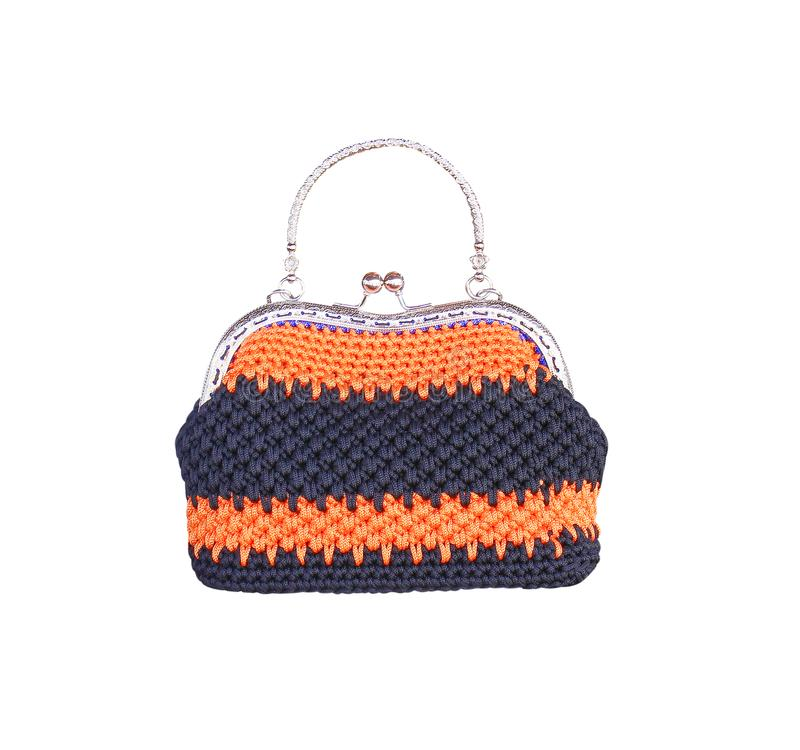 Colorful orange and black crochet knitted hand bag and decoration with steel handle isolated on white background with clipping pat royalty free stock photography