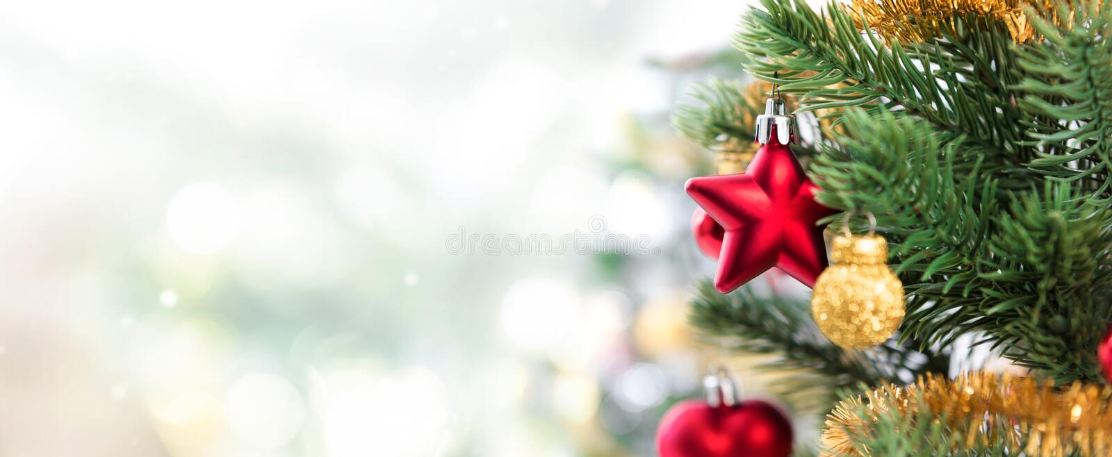 Close up of colorful ornaments on Christmas tree, panoramic banner stock photo