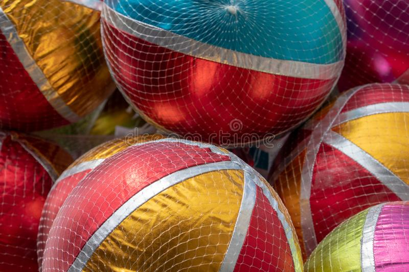 Close-up of Colorful shiny balloons with white stripes and colored areas at a fairground. Fun royalty free stock photos