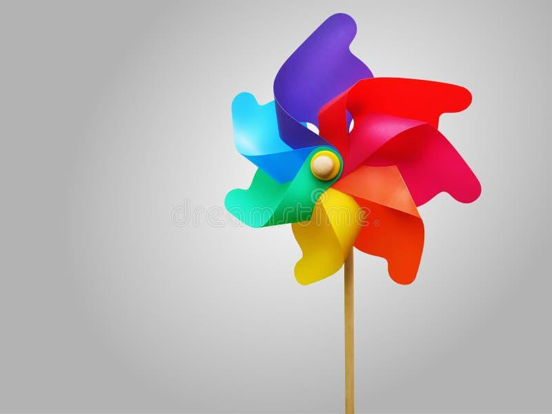 Colorful Vibrant Rainbow Turbine Wheel Isolated on Gray Background stock image
