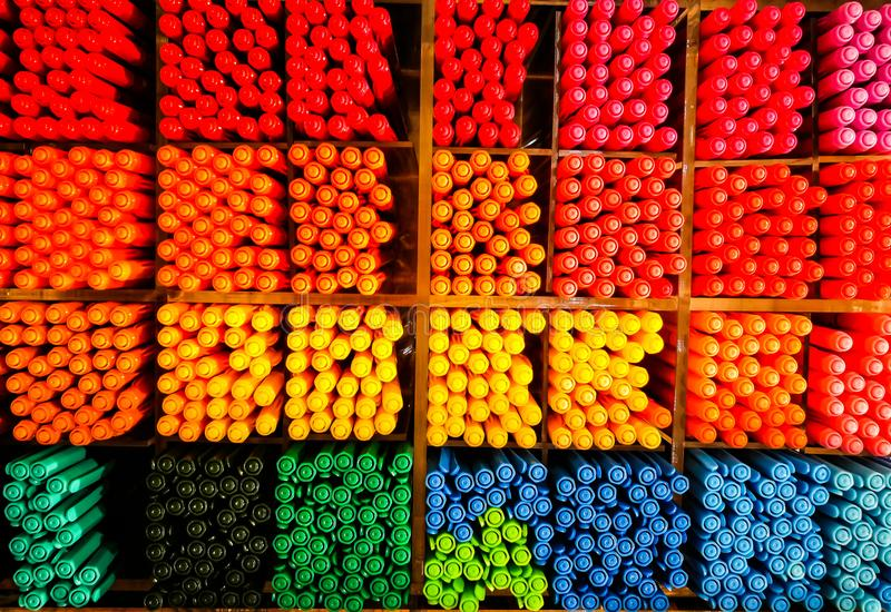 Close up coloured pen in top view at their partition at stationary store. royalty free stock photo